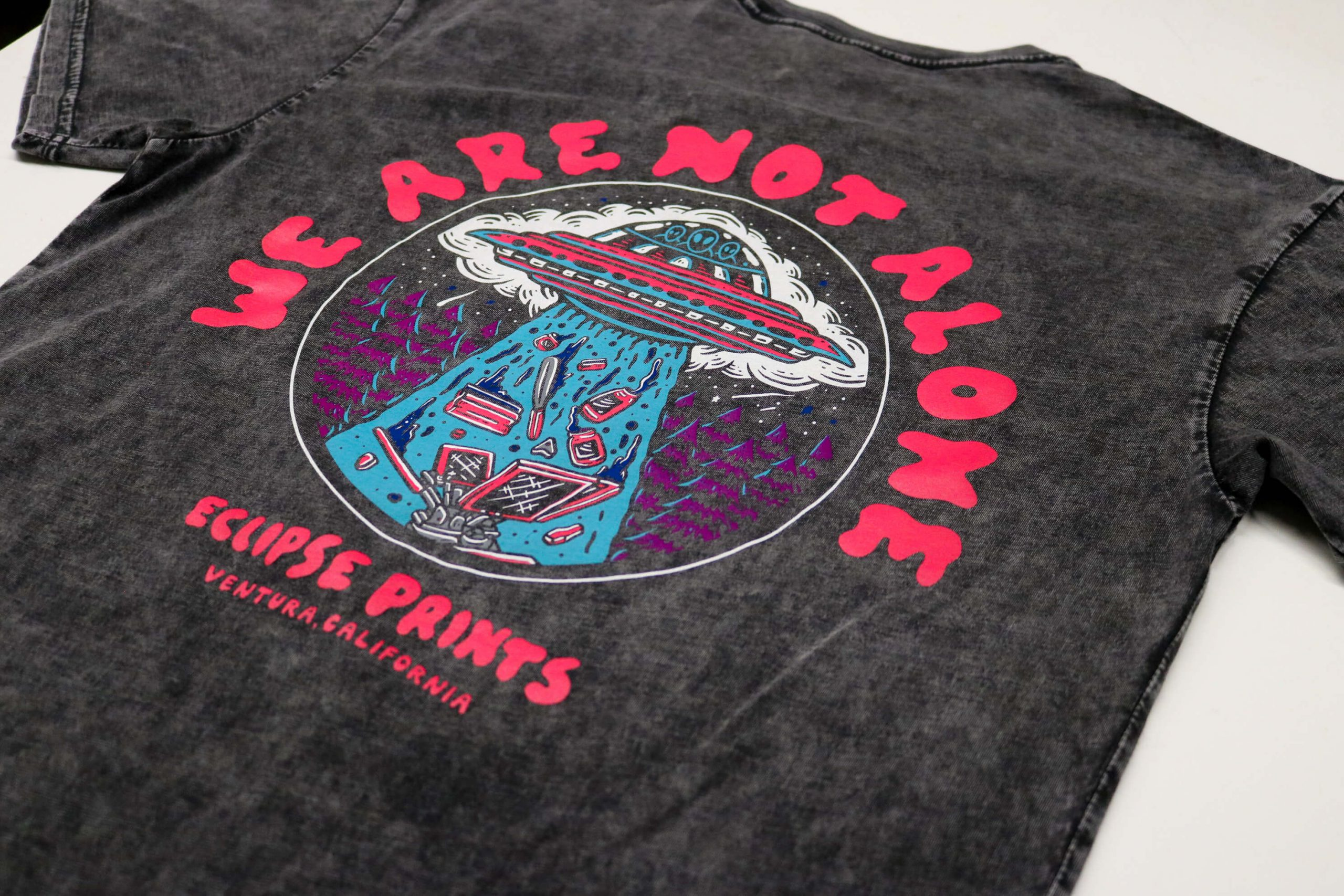 Screen printed shirt that has a UFO design. Screen printed with water based inks.
